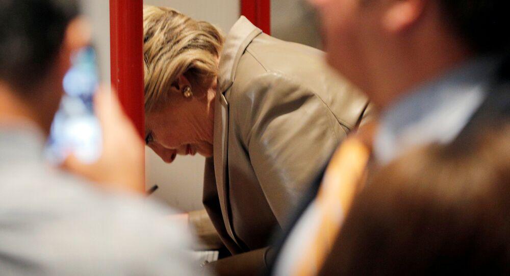 U.S. Democratic presidential nominee Hillary Clinton fills out her ballot at the Douglas Grafflin Elementary School in Chappaqua, New York, U.S. November 8, 2016