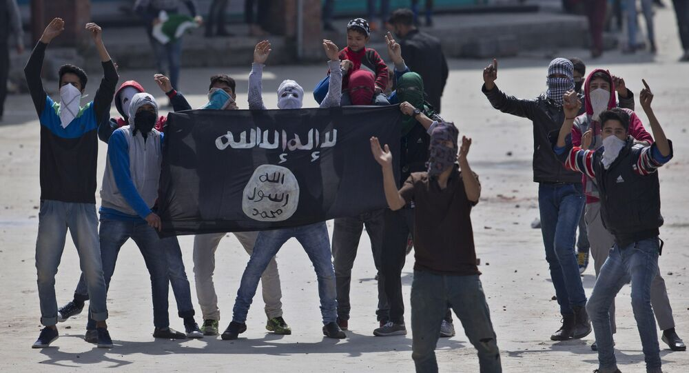 Kashmiri Muslim protesters hold a flag of Islamic State as they shout anti-India slogans during a protest in Srinagar, Indian controlled Kashmir, Friday, April 8, 2016