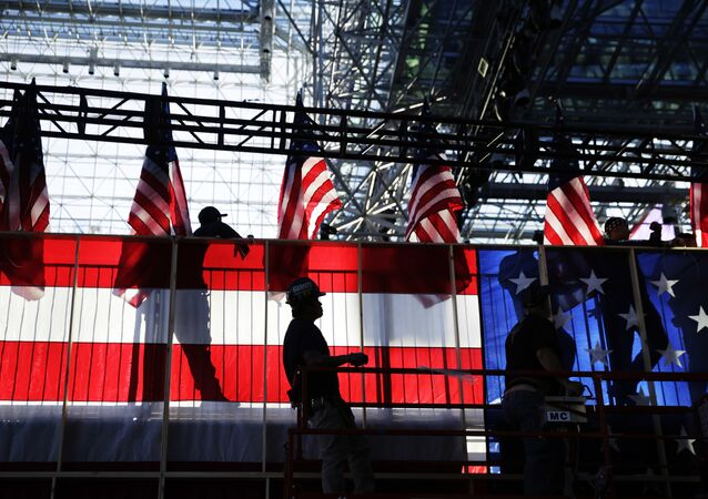 Workers build an American flag to the back of a riser in preparation for Democratic presidential candidate Hillary Clinton's election night rally in New York, Monday, Nov. 7, 2016