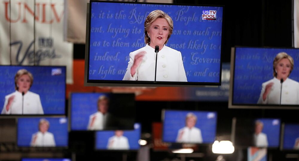Democratic US presidential nominee Hillary Clinton is shown on TV monitors in the media filing room on the campus of University of Nevada, Las Vegas, during the last 2016 US presidential debate in Las Vegas, US., October 19, 2016.