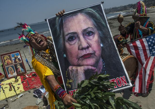 Shamans perform a ritual of predictions for the upcoming US election with posters of presidential candidates Donald Trump and Hilary Clinton at the Agua Dulce beach in Lima on November 7, 2016