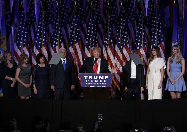 U.S. President-elect Donald Trump, along with his family and running mate Mike Pence, addresses supporters during his election night rally in Manhattan, New York, U.S., November 9, 2016