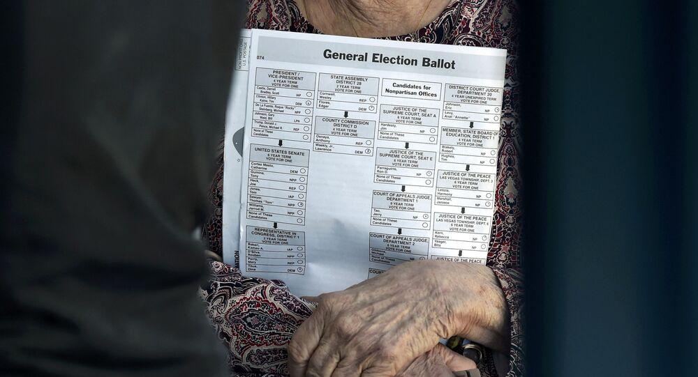 A woman carries her sample ballot