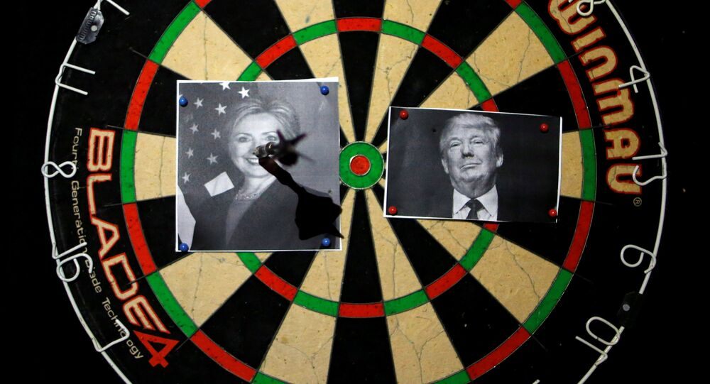 A dart board with images of Republican U.S. presidential candidate Donald Trump (R) and Democratic U.S. presidential candidate Hillary Clinton is seen at an election event held by Republicans Overseas Israel at a bar in Jerusalem November 9, 2016