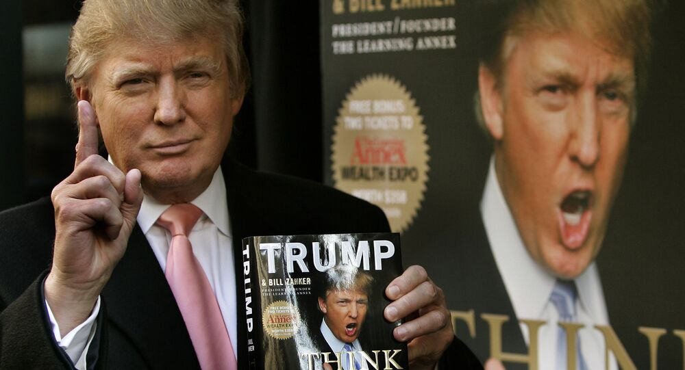 This file photo taken on October 16, 2007 shows Real estate developer Donald J. Trump holding up a copy of his new book written with Bill Zanker, president and founder of The Learning Annex, called Think Big and Kick Ass outside Barnes & Noble on 5th Avenue in New York
