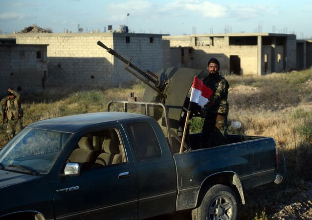A Syrian army fighter in the village of Kaukab in the Hama province