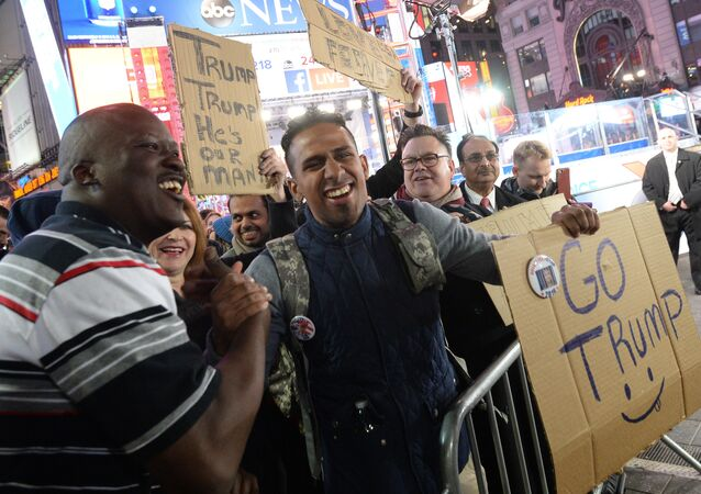 Supporters of Republican candidate Donald Trump on Times Square in New York follow the preliminary vote results