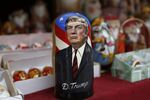 A traditional wooden Matryoshka doll depicting President-elect Donald Trump is displayed at a shop in Kiev, Ukraine, Wednesday, Nov. 9, 2016