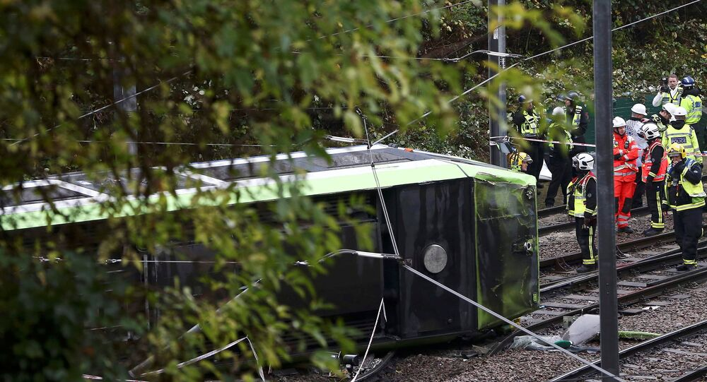Members of the emergency services work next to a tram after it overturned injuring and trapping some passengers in Croydon, south London, Britain November 9, 2016