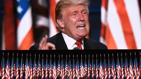 This file photo taken on July 21, 2016 shows US Republican presidential candidate Donald Trump speaks on the last day of the Republican National Convention in Cleveland, Ohio. Donald Trump said on November 9, 2016 he would bind the nation's deep wounds and be a president for all Americans, as he praised his defeated rival Hillary Clinton. - Sputnik International