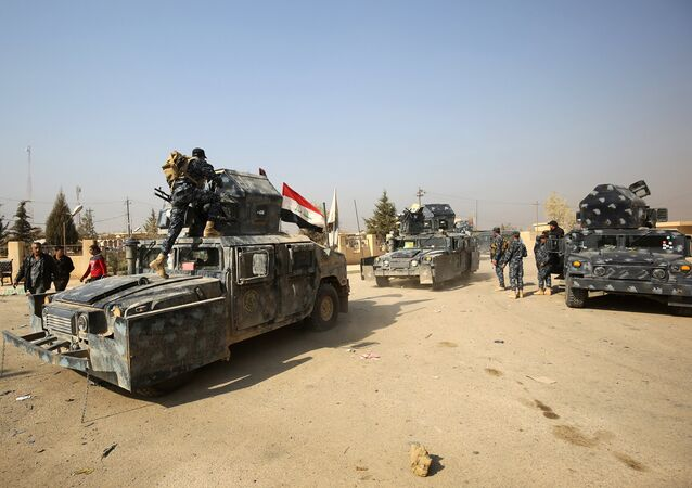 Iraqi forces patrol the Hamam al-Alil area, about 14 kilometres from the southern outskirts of Mosul, on November 7, 2016