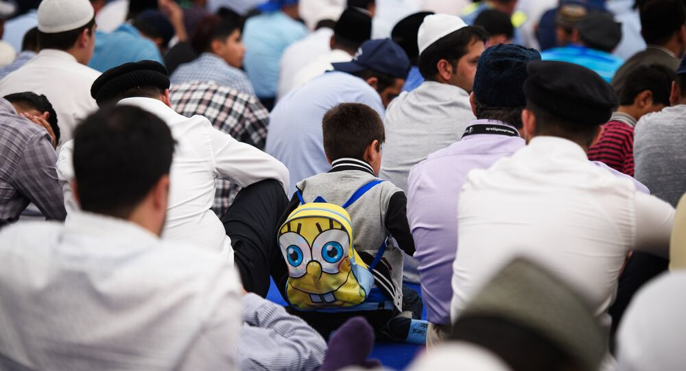 Members of the Ahmadiyya Muslim community prepare to listen to a speech by the fifth Caliph of the Ahmadiyya faith, Mirza Masroor Ahmad, during an annual three-day event, known as the Jalsa Salana, in Hampshire on August 21, 2015.