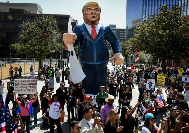 Members of the 'Full Rights for Immigrants Coalition' display a giant effigy of US Republican Party presidential hopeful Donald Trump during a protest on May Day in Los Angeles, California on May 1, 2016