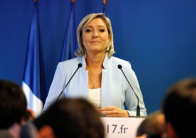Marine Le Pen, French National Front (FN) political party leader, delivers a statement on US election results at the party headquarters in Nanterre, France, November 9, 2016
