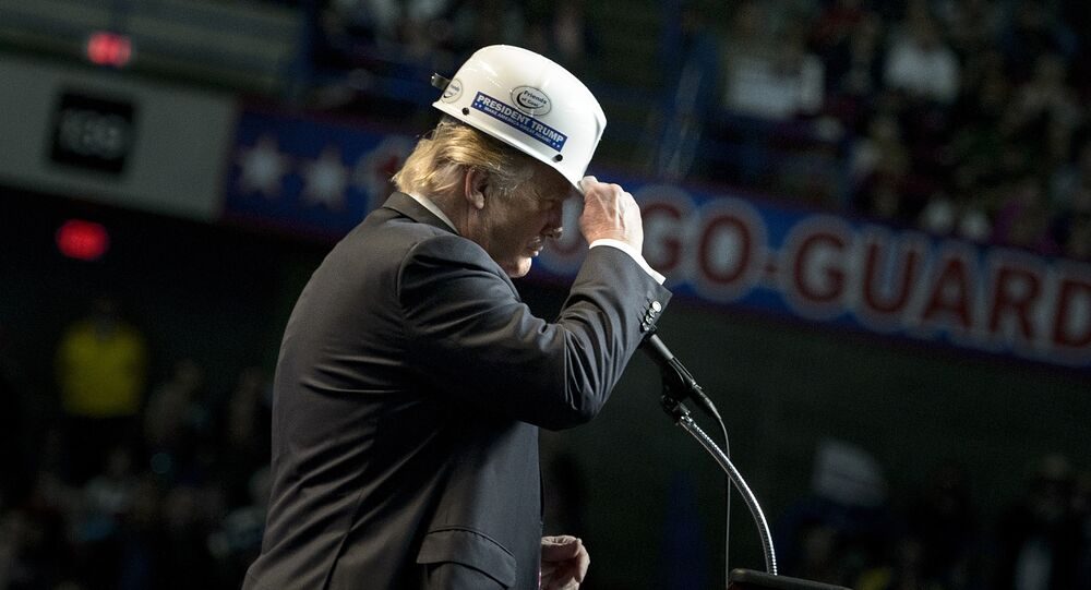 US Republican presidential candidate Donald Trump puts on a miner's hat while speaking during a rally on May 5, 2016 in Charleston, West Virginia