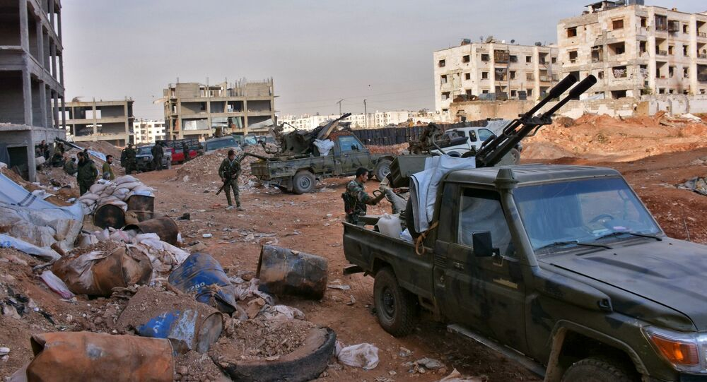 Syrian pro-government forces hold a position in Aleppo's 1070 district on November 8, 2016, after seizing it from rebel fighters