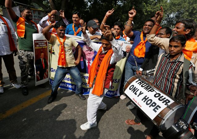 Members of Hindu Sena, a right-wing Hindu group, celebrate Republican presidential nominee Donald Trump's victory in the U.S. elections, in New Delhi, India, November 9, 2016