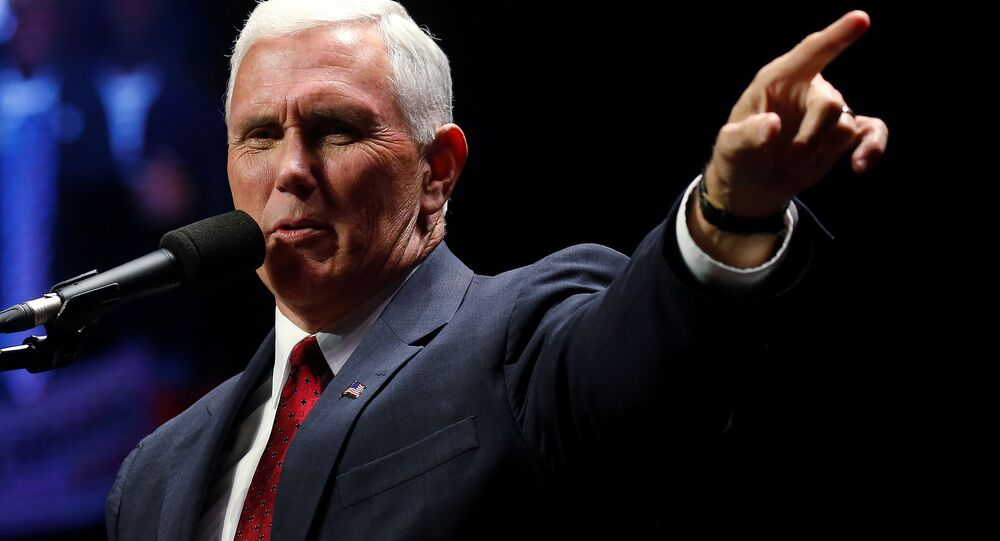 Republican vice presidential nominee Mike Pence attends a campaign rally in Manchester, New Hampshire, U.S. November 7, 2016