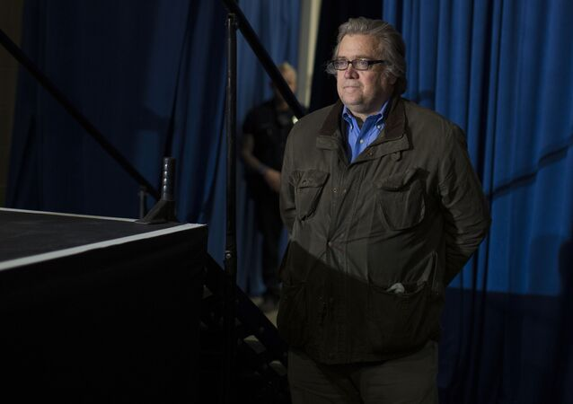 Stephen Bannon, campaign CEO for Republican presidential candidate, Donald Trump, looks on as Trump speaks during a campaign rally, Saturday, Nov. 5, 2016, in Denver