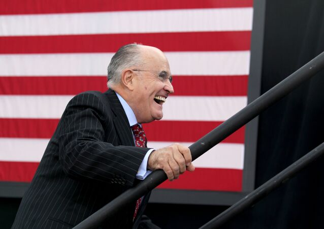 Former New York City mayor Rudy Giuliani smiles as he takes the stage to speak before Republican presidential candidate Donald Trump at an event on October 15, 2016 in Portsmouth, New Hampshire