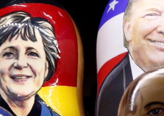 Painted Matryoshka dolls, or Russian nesting dolls, bearing the faces of German Chancellor Angela Merkel an US President-elect Donald Trump