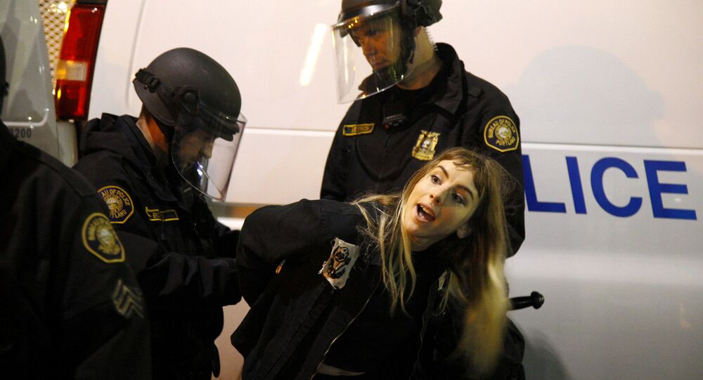 Police detain a demonstrator during a protest against the election of Republican Donald Trump as President of the United States in Portland, Oregon, U.S. November 10, 2016