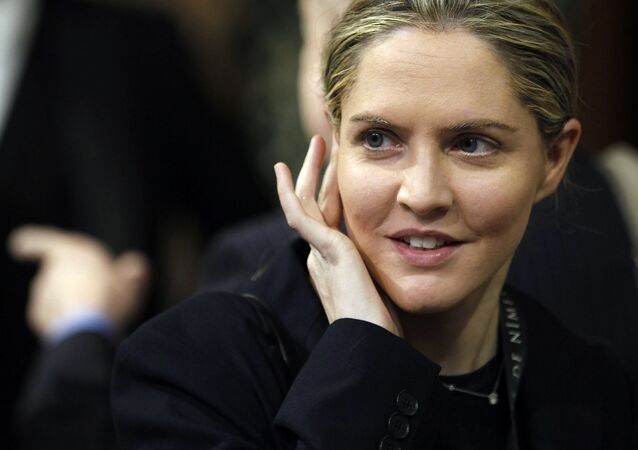 Then Conservative Member of Parliament Louise Mensch arrives in the Members' Lobby of the House of Commons to attend the State Opening of Parliament at the Palace of Westminster in London on May 9, 2012.