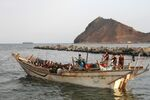 African illegal immigrants sit on a boat in the southern port city of Aden on September 26, 2016, before being deported to Somalia