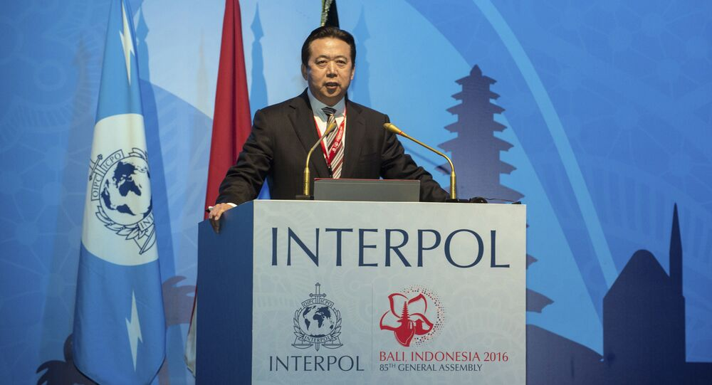 In this photo released by Xinhua News Agency, China's Vice Minister of Public Security Meng Hongwei delivers a campaign speech at the 85th session of the general assembly of the International Criminal Police Organization (Interpol), in Bali, Indonesia, Nov. 10, 2016