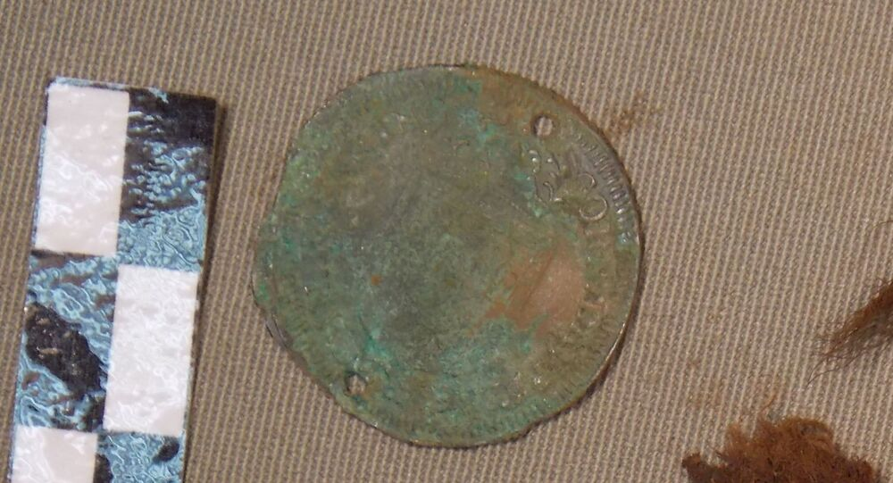 Counting tokens with a portrait of Louis XIV King of France and Navarre