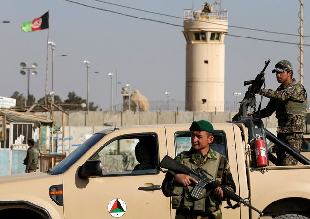 Afghan National Army (ANA) soldiers keep watch outside the Bagram Airfield entrance gate, after an explosion at the NATO air base, north of Kabul, Afghanistan November 12, 2016.