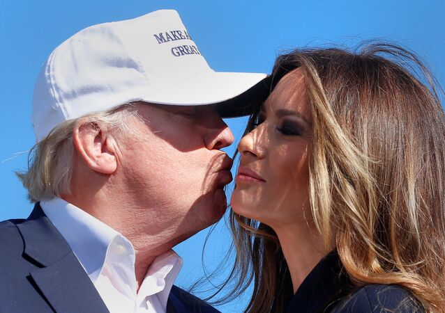Republican presidential nominee Donald Trump kisses his wife Melania Trump at a campaign rally on 5 November 2016.