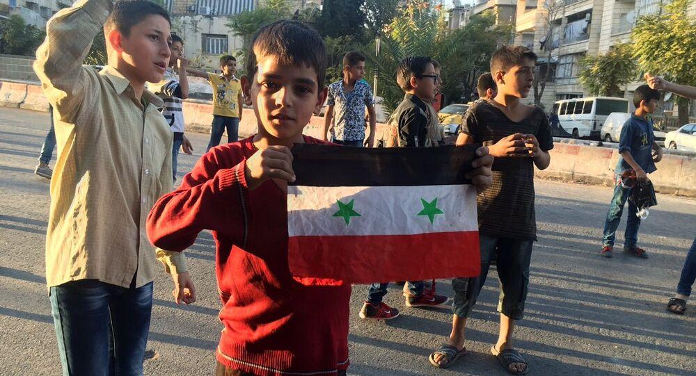 Children in the humanitarian corridor Bustan al-Qasr on the Eastern-Western Aleppo border, Syria.