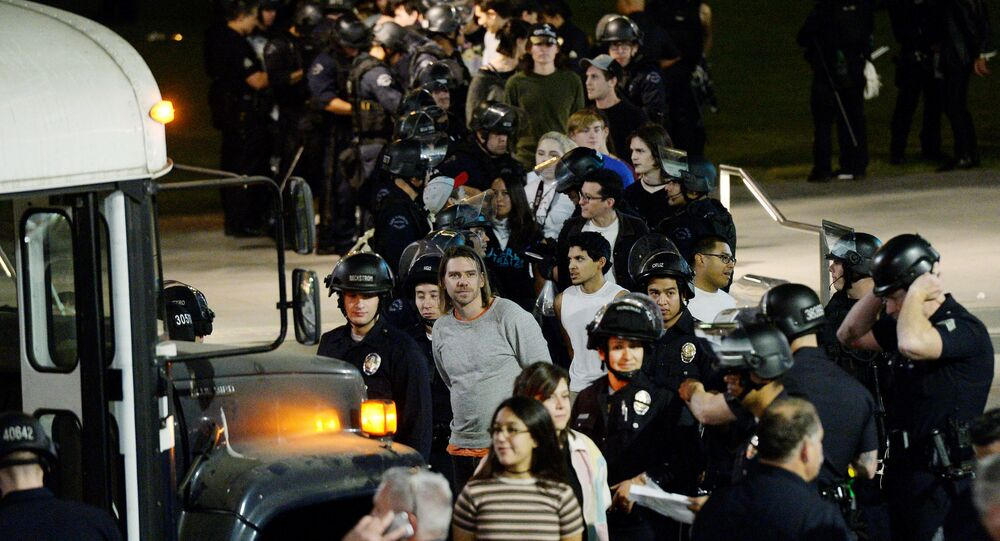 Protestors are detained by Los Angeles Police Department officers after a march and rally against the election of Republican Donald Trump as President of the United States in Los Angeles, California, U.S
