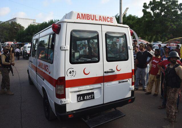 Pakistani paramilitary soldiers escort an ambulance