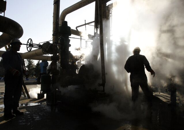 Worker repairs a part of a unit of the Tehran oil refinery, in Tehran, Iran. (File)