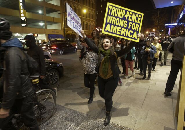 Demonstrators march following a protest against President-elect Donald Trump in downtown Indianapolis on Saturday, Nov. 12, 2016.