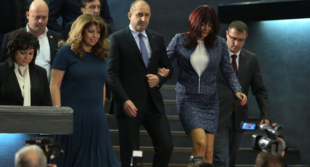 Presidential candidate of the Bulgarian Socialist Party Rumen Radev arrives for a news conference with his wife Desislava in Sofia, Bulgaria, November 13, 2016.
