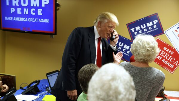 Republican presidential candidate Donald Trump talks on the phone as he visits a call center before a rally in Asheville, N.C. (File) - Sputnik International