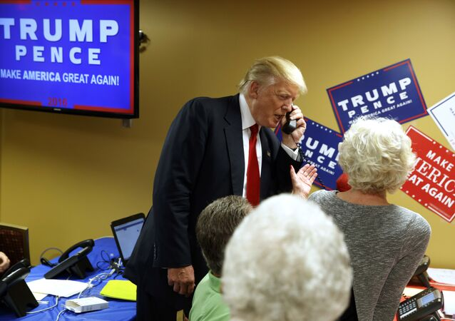 Republican presidential candidate Donald Trump talks on the phone as he visits a call center before a rally in Asheville, N.C. (File)