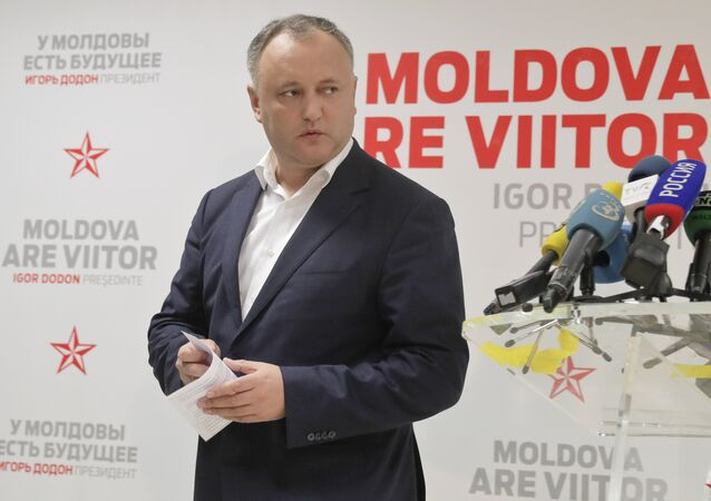 Socialist Party presidential candidate Igor Dodon leaves after a press briefing in Chisinau, Moldova, Sunday, Nov. 13, 2016.