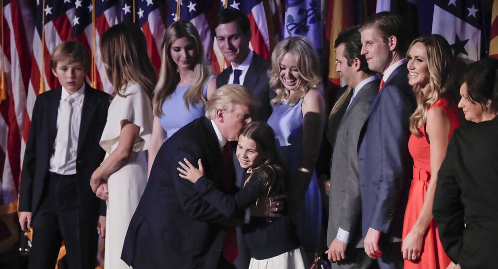 President elect Donald Trump greets members of his family after giving an his acceptance speech at an election night rally, Wednesday, Nov. 9, 2016, in New York.