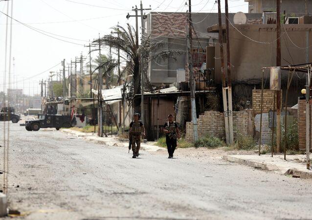 Members with Iraqi counter-terrorism forces patrol Fallujah, Iraq. (File)
