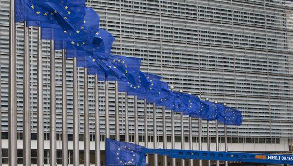 Workers adjust the EU flags in front of EU headquarters in Brussels. (File) - Sputnik International