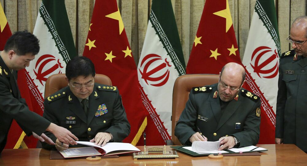 Chinese Defense Minister Chang Wanquan and his Iranian counterpart General Hossein Dehghan Signing Cooperation Deal