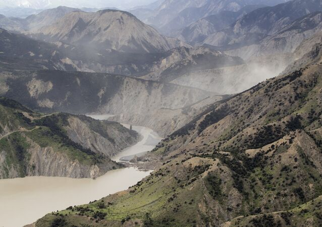 This aerial photo taken and received on November 14, 2016 shows dust created by a strong after-shock hanging above the Clarence River which was blocked, causing a huge dam, north of Kaikoura on the South Island's east coast.