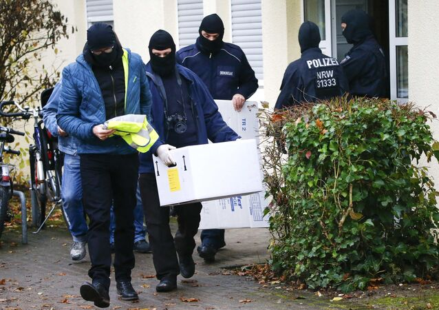 German special police leave a house in Bonn November 15, 2016.
