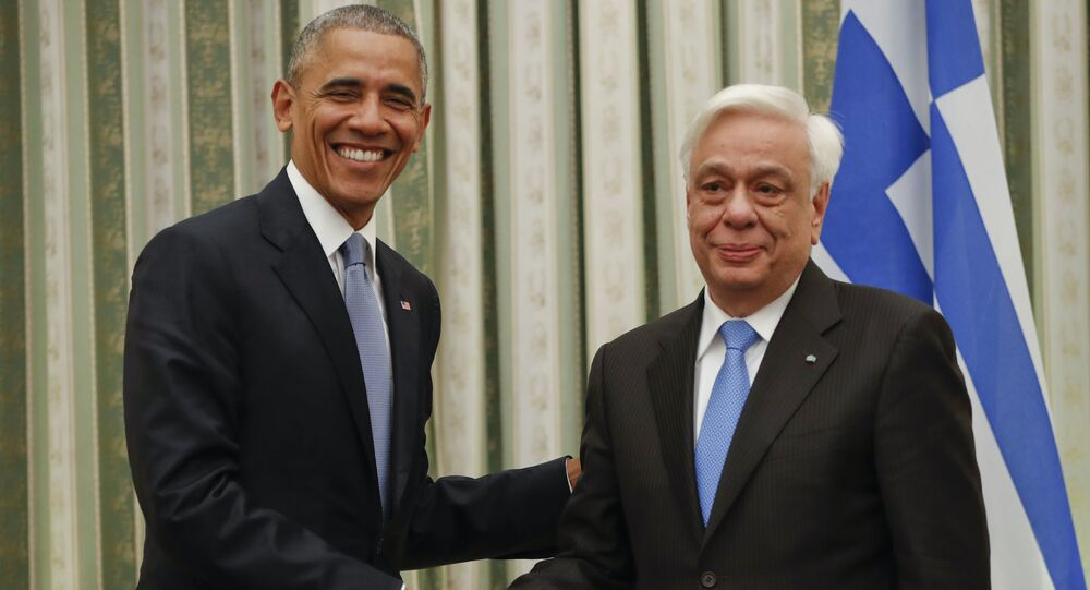 President Barack Obama shakes hands with his Greek counterpart Prokopis Pavlopoulos during their meeting at the Presidential Mansion in Athens