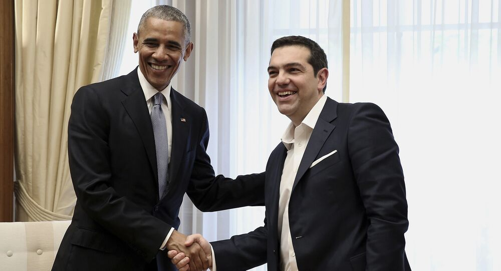 U.S. President Barack Obama, left, shake hands with Greek Prime Minister Alexis Tsipras during their meeting at Maximos Mansion in Athens