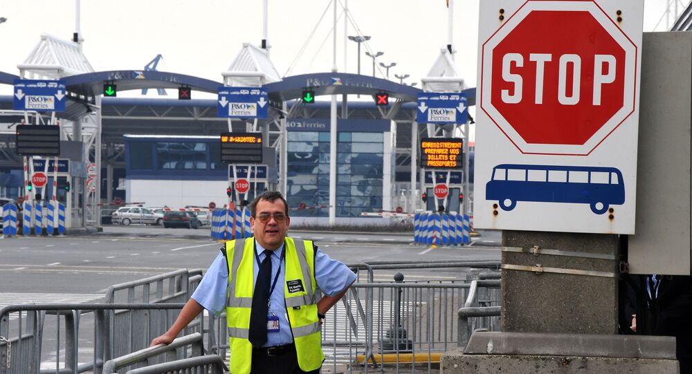 A member of the UK Border agency stands at the entrance of the Channel Ferries in Calais, northern France, on January 27, 2009 .